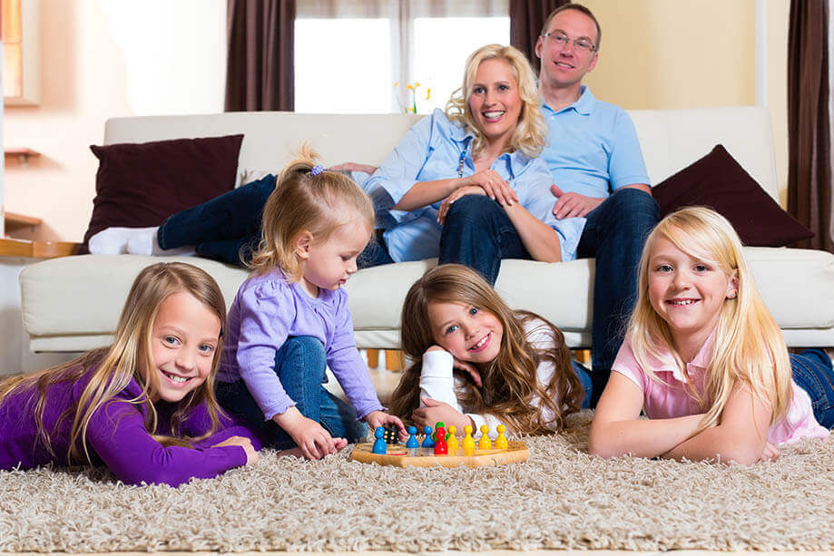 Family relaxing on clean carpet and couch